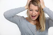 Stressed blond woman shouting