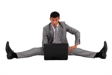 Man sitting on the floor with his laptop