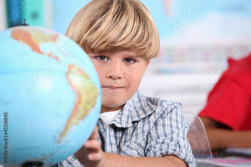 Kid learning geography.