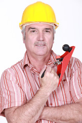 Man with hand tool
