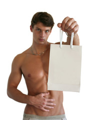Young Sexy Man with a Shopping Bag