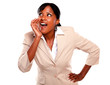 Ethnic businesswoman screaming and looking right