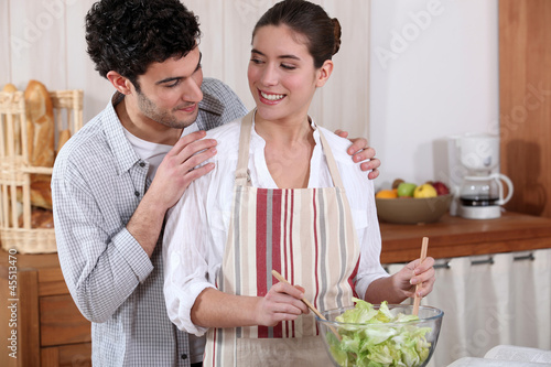 Couple preparing a salad together