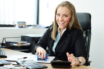Pretty blondy smiling and calculating