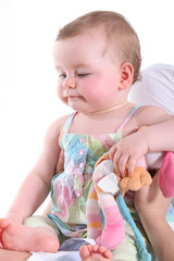 Baby girl being held in a sitting position