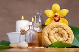Fototapety Orchid flower, towel, aroma oils, zen stones