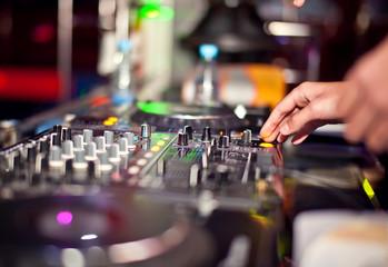 Dj mixing in night club