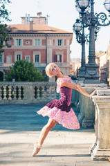 Young beautiful ballerina dancing in Bologna, Italy.