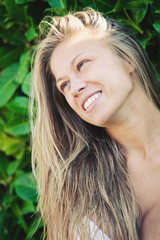 Young beautiful blonde laughing woman portrait.