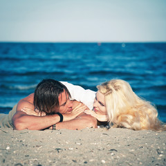 Young couple in love relaxing at the beach.