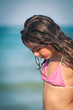 Intimate portrait of young girl on the beach. Shallow depth of f