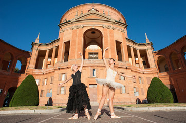 Young beautiful dancers in front of San Luca church. Bologna, It