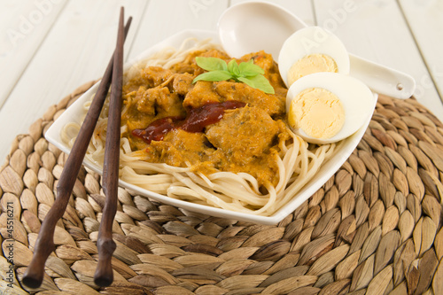 Dry Curry Mee - Malaysian chicken curry on noodles. Egg & sambal