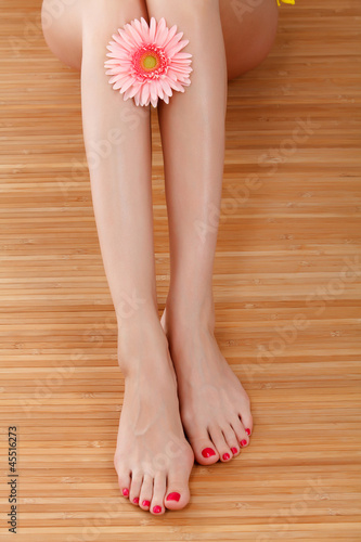 Female feet with a flower