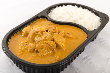 Takeaway curry - Chicken curry and rice in a plastic container