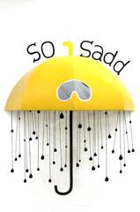 Yellow umbrella so sad