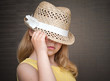 Portrait of a little blond girl with straw hat