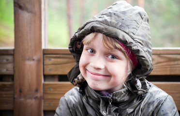 Portrait of a smiling little blond girl  in a casual jacket