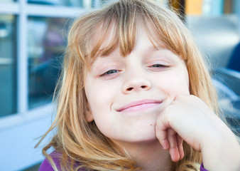 Portrait of a little smiling blond girl