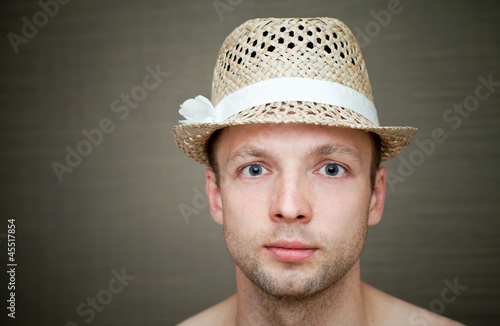 Young man in a fun straw hat