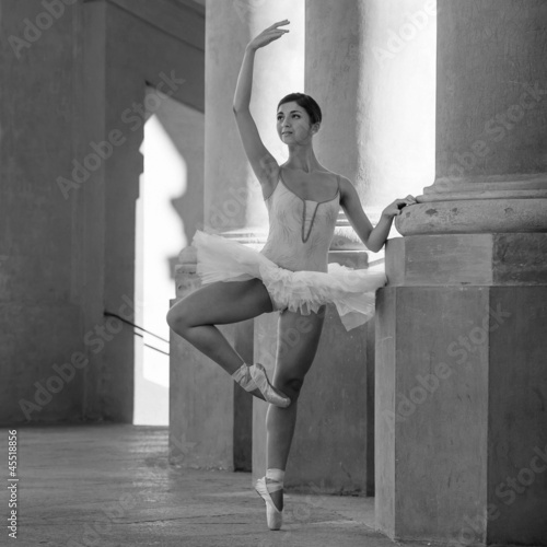 Young beautiful ballerina dancing in front of St. Luca church.  - 45518856