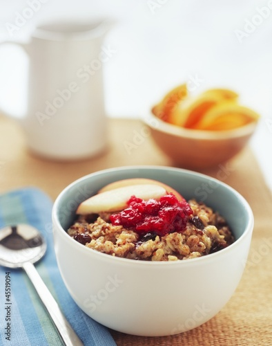 Bowl of Raisin Oatmeal with Apples and Cranberries
