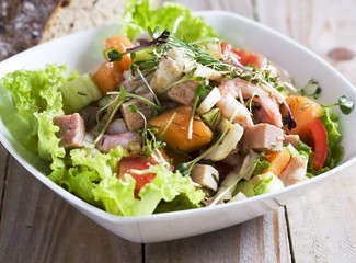 Ham salad with prawns and melon