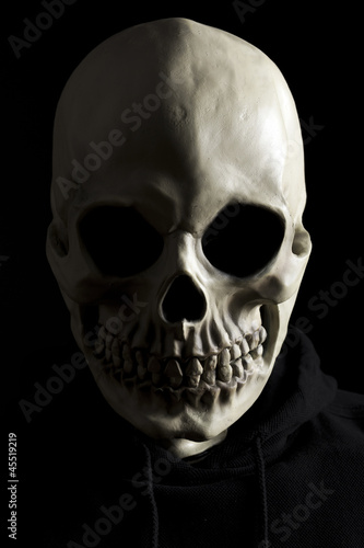 Scary skeleton on black background