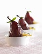 Poached Pears with Candies Orange Peels in White Bowls