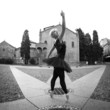 Young beautiful ballerina dancing out in the street.
