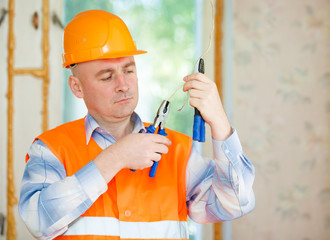 Electrician repairing ceiling wiring