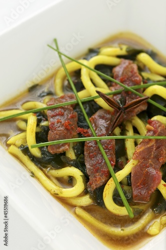 Beef with Japanese mountain pepper, udon noodles and seaweed in vegetable soup