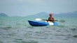 Woman kayaking at tropical sea