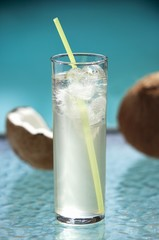 Glass of Coconut Water with Ice and a Straw