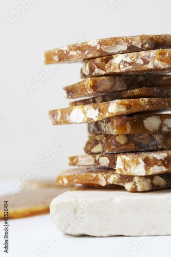 Caramel with Hazelnuts; Stacked on Stone Tile