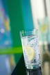 A glass of sparkling mineral water with a wedge of lemon