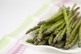 Green asparagus on tea towel