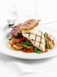 Chicken breast with Parma ham on green beans and tomatoes