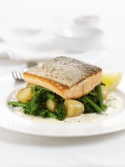 Salmon trout fillet on broccoli and potatoes