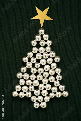 A sliver Christmas tree made of sugar balls