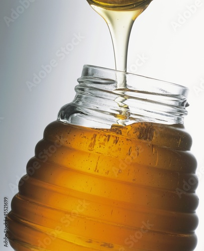 Honey in jar with spoon