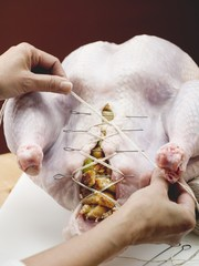 Closing up stuffed turkey with kitchen string