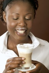 Woman drinking latte macchiato