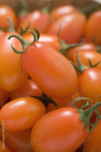 Cherry tomatoes in woodchip basket (detail)