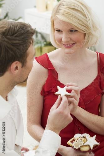 Man handing woman a cinnamon star