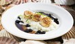 Fried scallops with cauliflower puree and raisins