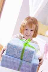 Little girl with Christmas parcels