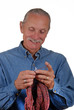 Middle aged man knitting