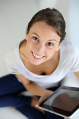 Upper view of young woman websurfing on internet