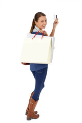 Trendy young girl holding shopping  bags, isolated